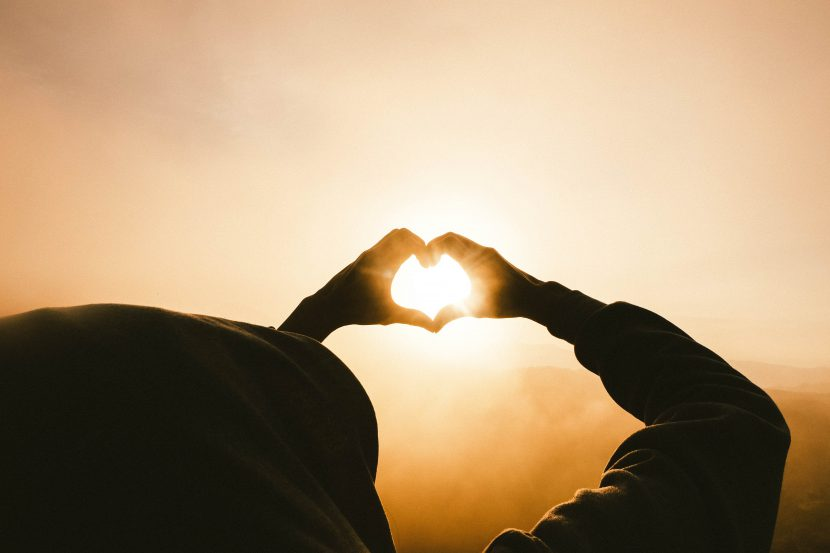 heart shape made from hands held up to the sun