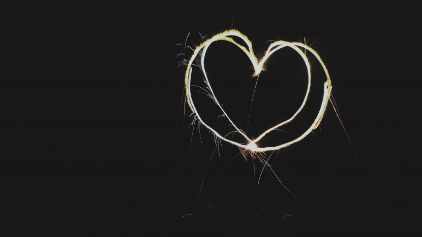 heart shape made out of sparklers in top right hand corner of picture