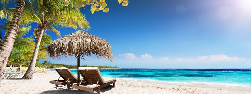 Caribbean Palm Beach With Wooden Chairs And Straw Umbrella - Idy